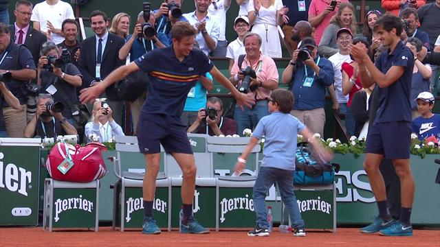 Mahut celebrates by dancing with his son