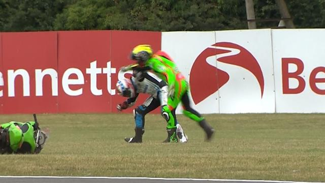 Rider throws punch after rival takes him out in Supersport crash