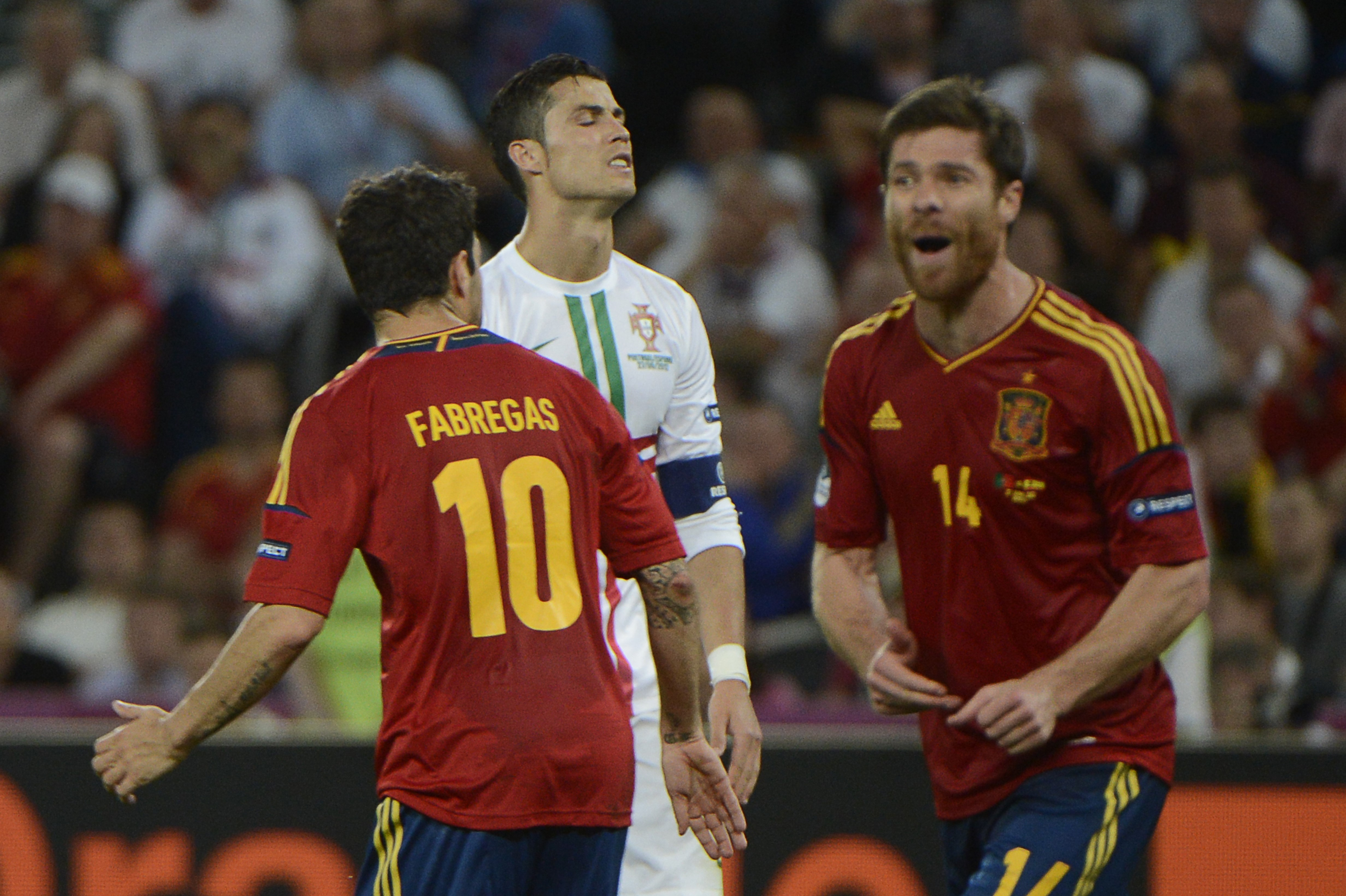 Cristiano Ronaldo (C) Cesc Fabregas and Xabi Alonso (R) during the Euro 2012 semi-final match Portugal vs Spain on June 27, 2012 at the Donbass Arena in Donetsk