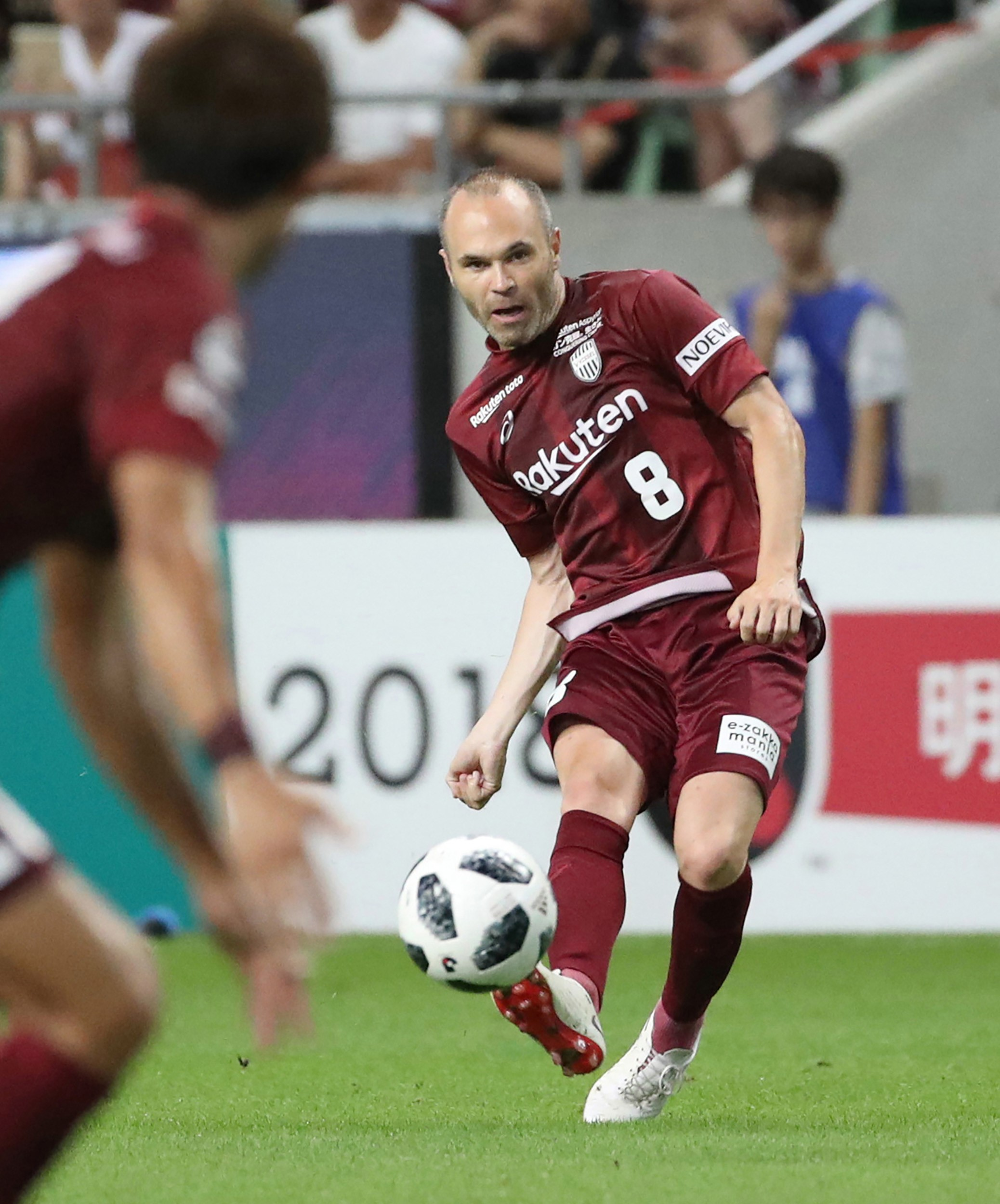 J-League club team Vissel Kobe's new signing, Spanish player Andres Iniesta (R), kicks the ball during a football match against Shonan Bellmare at Noevir Stadium in Kobe, Hyogo prefecture on July 22, 2018.