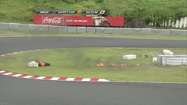 Ohnuki's bike burns on the circuit after crash