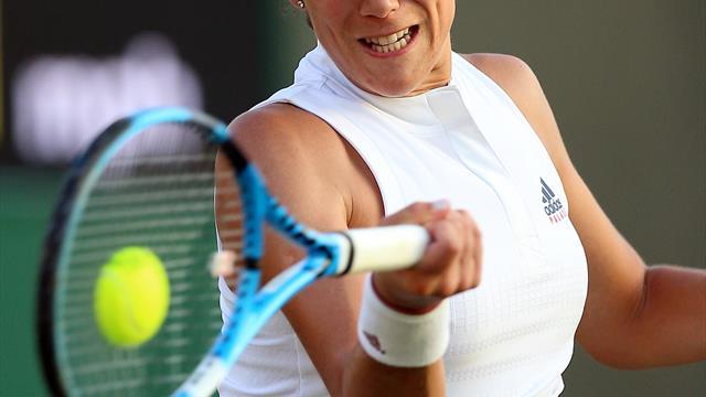 Muguruza out of WTA event with arm injury