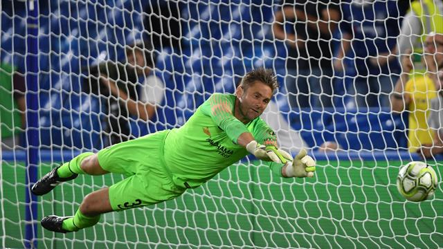 Green the hero as Chelsea beat Lyon on penalties