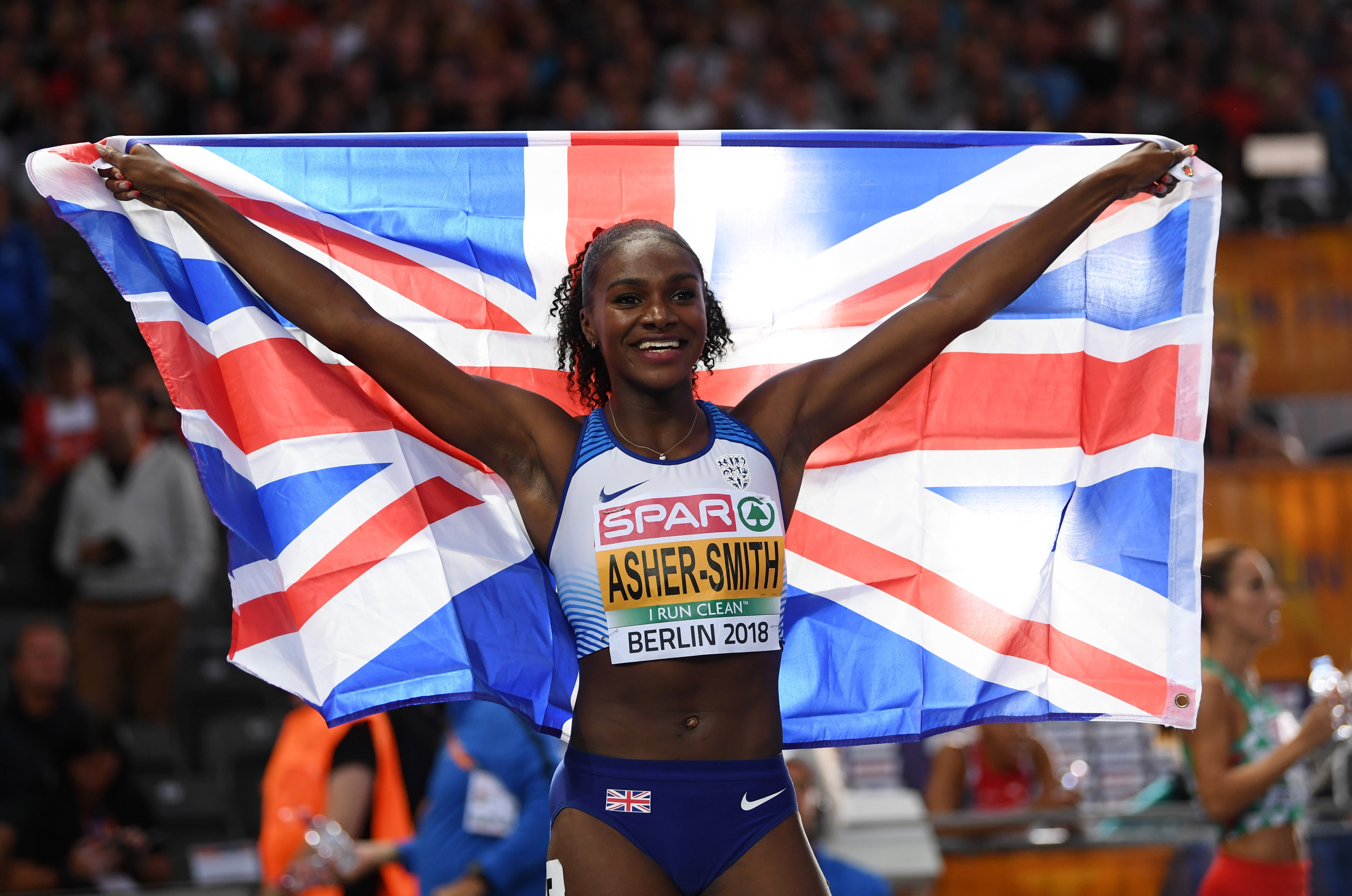 Dina Asher-Smith of Great Britain celebrates winning gold in the Women's 200 metres final during day five of the 24th European Athletics Championships at Olympiastadion on August 11, 2018 in Berlin, Germany.