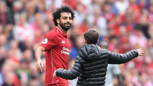 PHOTOS: Salah hugs young fan on pitch during match