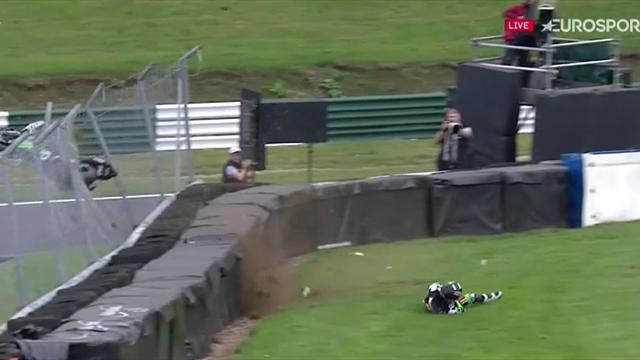 Buchan crashes, bike leaps 15ft into fence