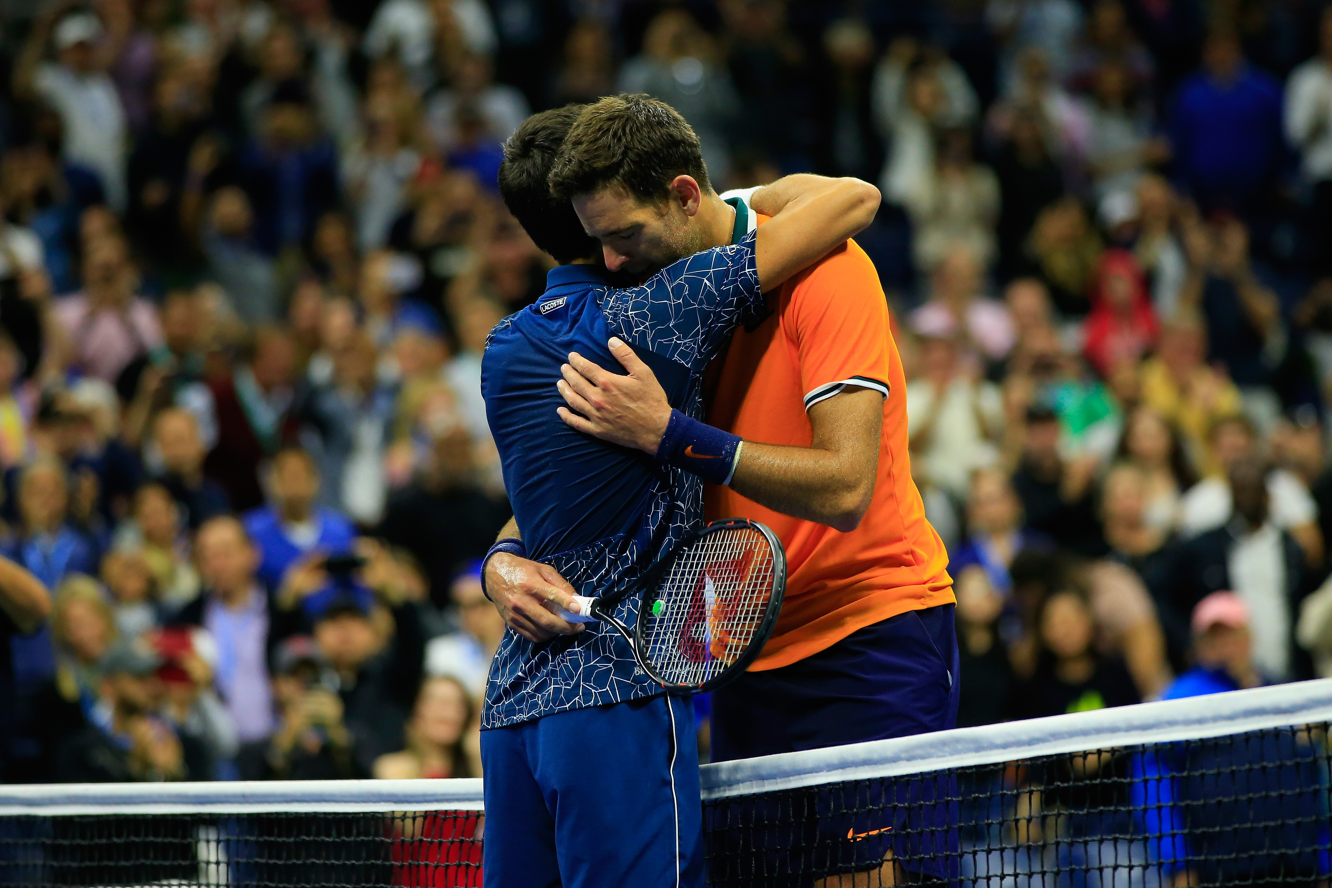 Novak Djokovic of Serbia is congratulated on his win by Juan Martin del Potro