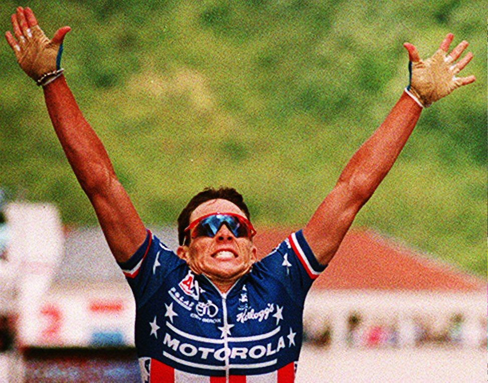 Lance Armstrong of the U.S. raises his arms after winning the eighth stage of the Tour de France 11 July 1993 in Verdun. Belgium's Johan Museeuw keeps the yellow jersey of overall leader