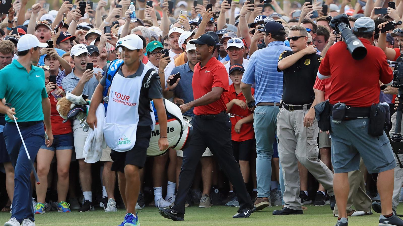 watch  tiger woods engulfed by jubilant crowd on 18th