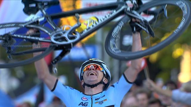 Victorious Evenepoel stops on finish line, lifts bike above his head
