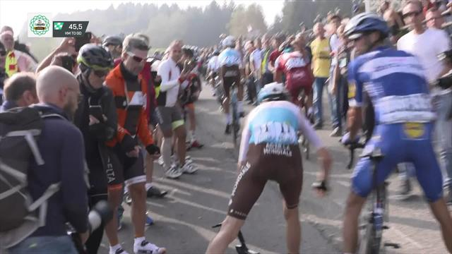 Romain Bardet wiped out by camera strap
