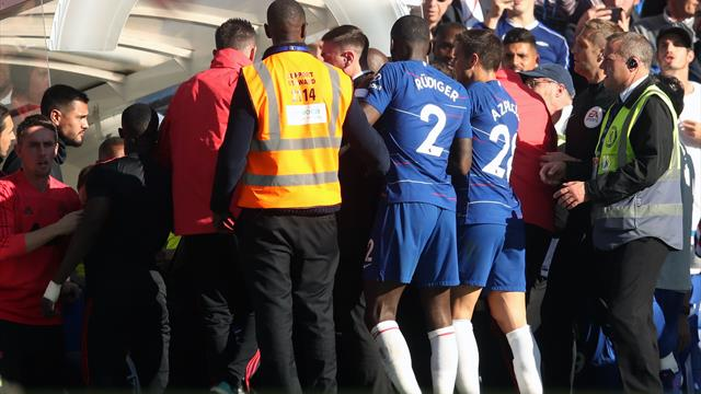 Jose Mourinho had to be restrained after Chelsea score late