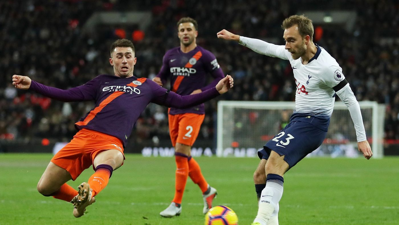 Christian Eriksen is denied by the flailing leg from Aymeric Laporte
