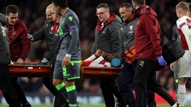 Arsenal reach last 32, Danny Welbeck suffers 'serious' ankle break