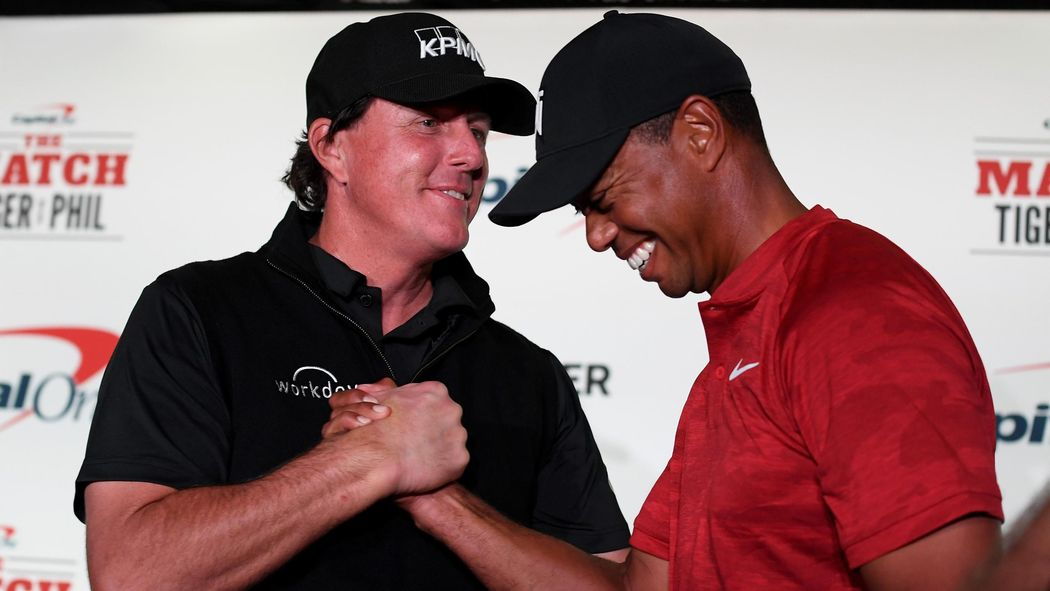 Grotesque' - Tiger Woods and Phil Mickelson photographed sat in