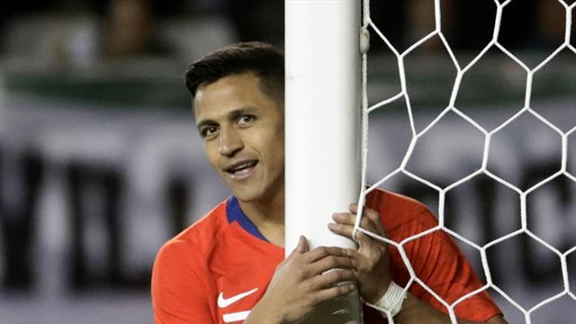 WATCH: Pitch-invading supporter slips celebrating Sanchez goal