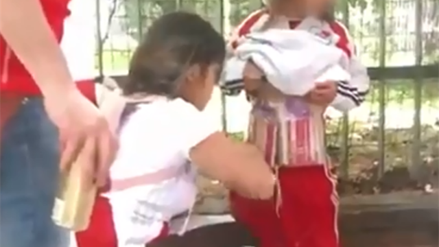 WATCH: River Plate fan attaches flares to child before entering stadium