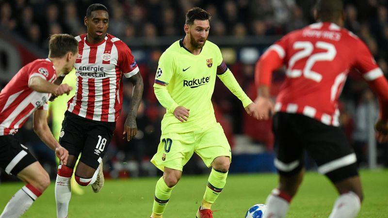 Barcelona's Argentine forward Lionel Messi (C) vies with Eindhoven's players during the UEFA Champions League football match between PSV Eindhoven and FC Barcelona at Philips stadium in Eindhoven on November 28, 2018.