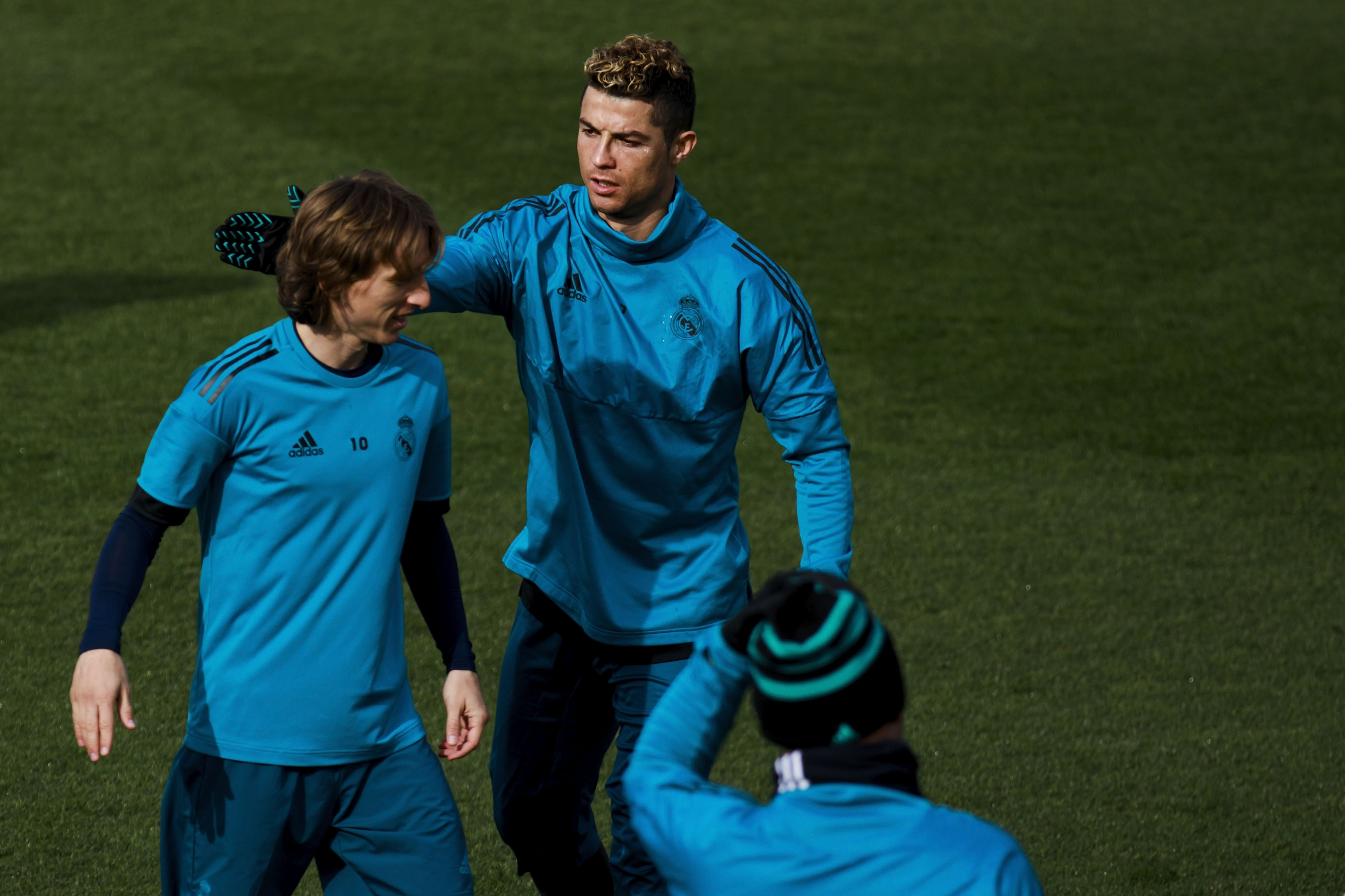 Cristiano Ronaldo (R) of Real Madrid CF jokes with his teammate Luka Modric (L)