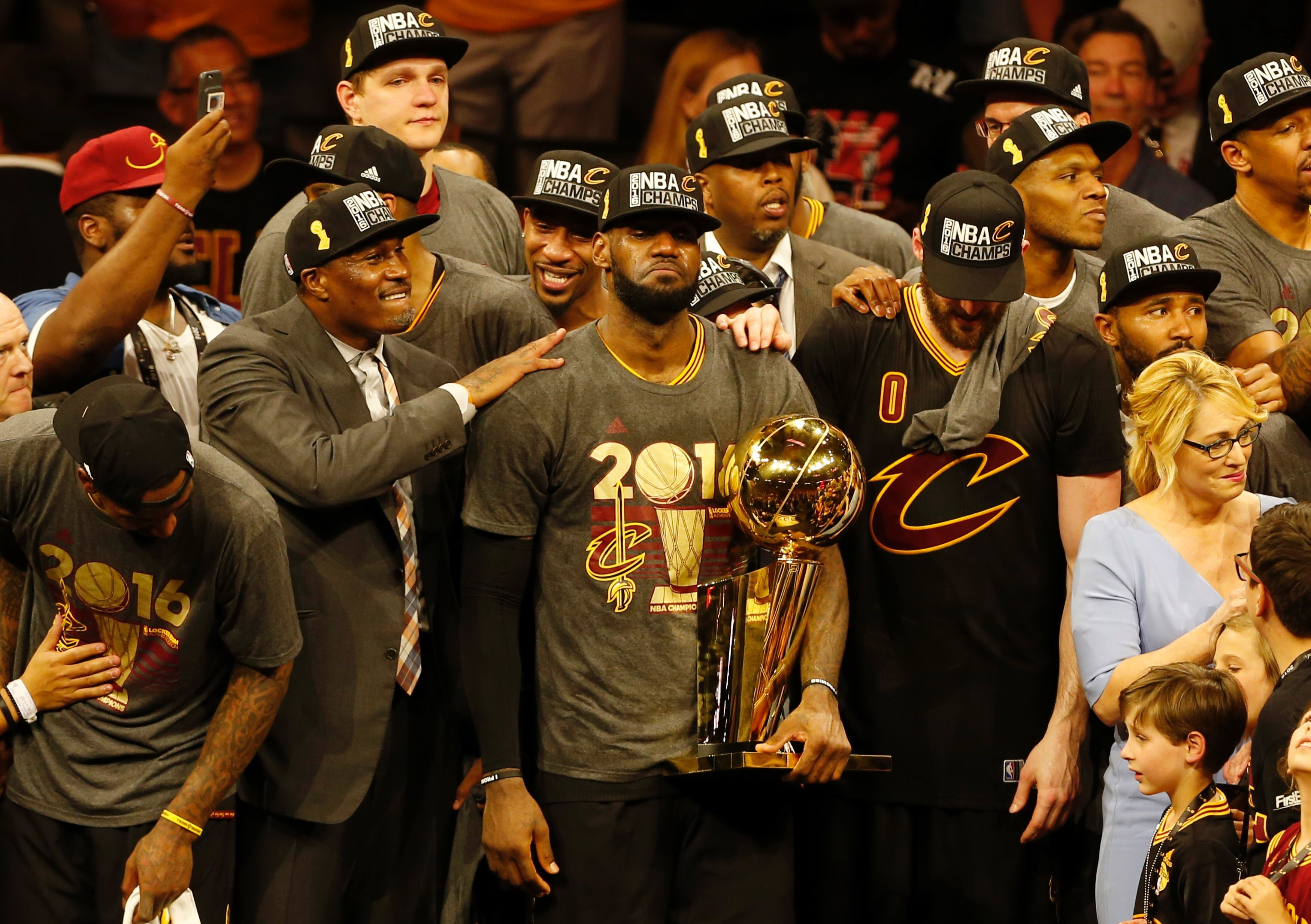 Cleveland Cavaliers forward LeBron James reacts while holding the Larry O'Brien trophy after defeating the Gold State Warriors to win the NBA Finals on June 19, 2016 in Oakland, California