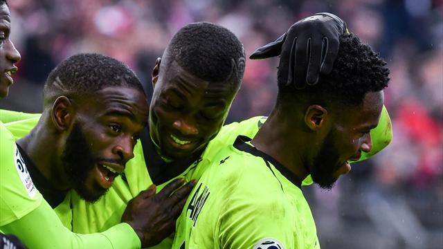 Lille shrug off early red card to beat Nimes 3-2