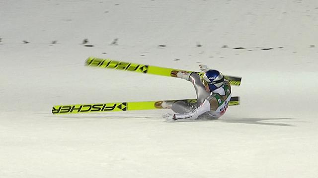 Wellinger stumbles after jump