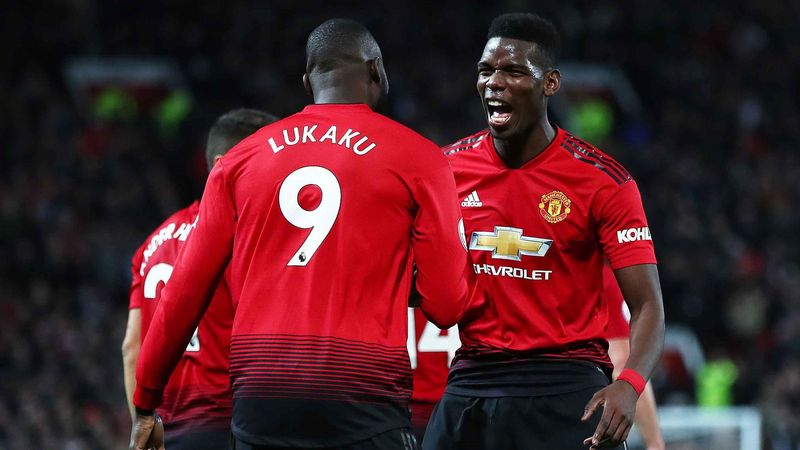 Romelu Lukaku of Manchester United celebrates after scoring his team's fourth goal with Paul Pogba during the Premier League match between Manchester United and AFC Bournemouth at Old Trafford on December 30, 2018 in Manchester, United Kingdom.