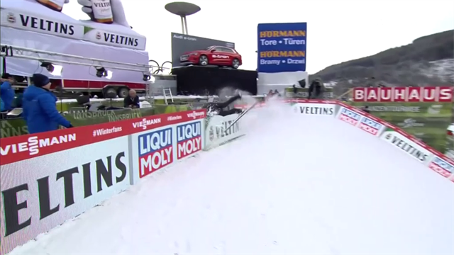 Ouch! - Sabirzhan Muminov careers into hoarding at Four Hills