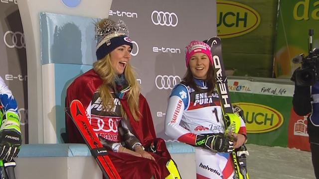 Ice-queen Shiffrin cringes as she is dressed in a cape on the podium