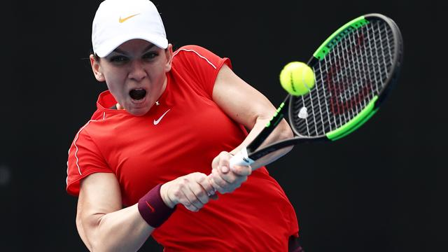 Coach-less Halep admits behind curve at Melbourne Park
