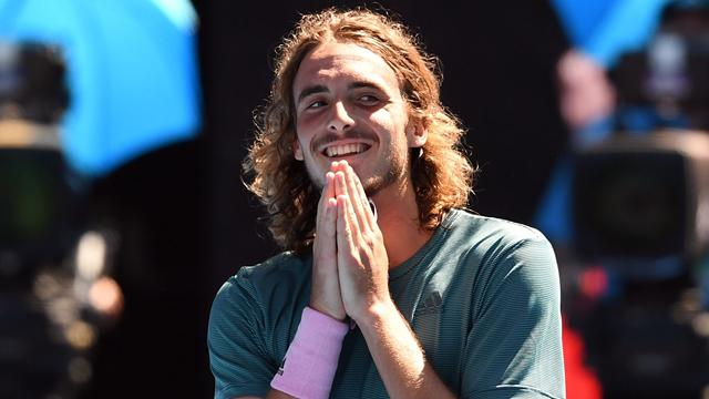 History-making Tsitsipas into semis after four-set win over battling Bautista Agut
