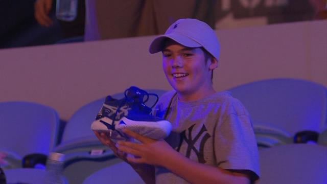 Djokovic gives his shoes to an excited young fan