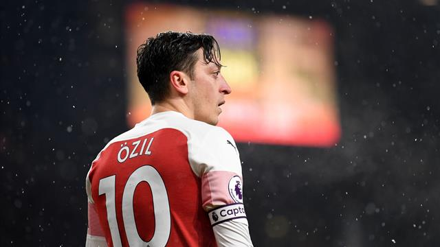 Ozil quotes Bergkamp in cryptic tweet to hint he will fight for Arsenal future