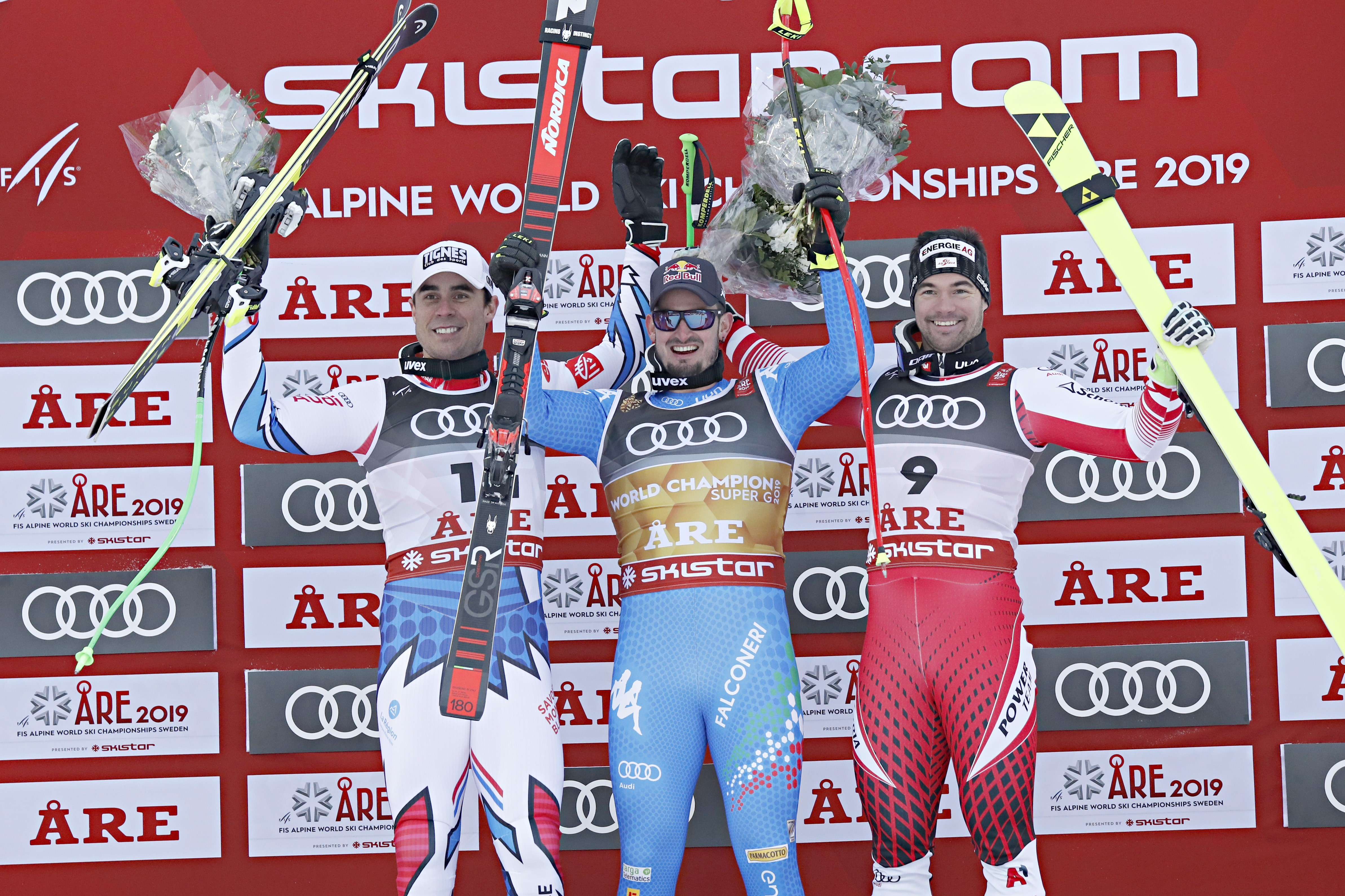 Johan Clarey of France wins the silver medal, Dominik Paris of Italy wins the gold medal, Vincent Kriechmayr of Austria wins the silver medal during the FIS World Ski Championships Men's Super G on February 6, 2019 in Are Sweden