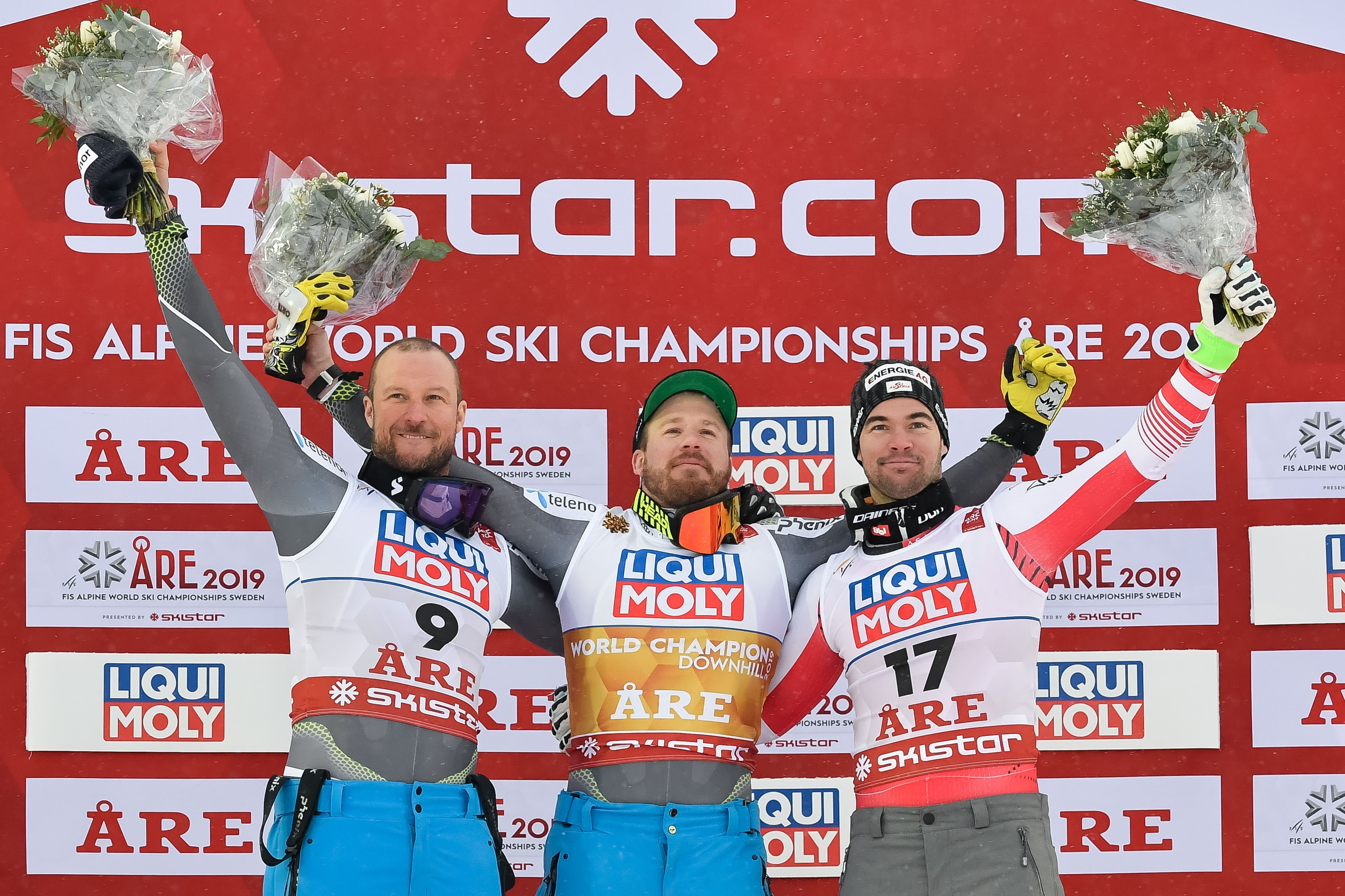 Aksel Lund Svindal of Norway wins the silver medal, Kjetil Jansrud of Norway wins the gold medal, Vincent Kriechmayr of Austria wins the bronze medal during the FIS World Ski Championships Men's Downhill on February 9, 2019 in Are Sweden.