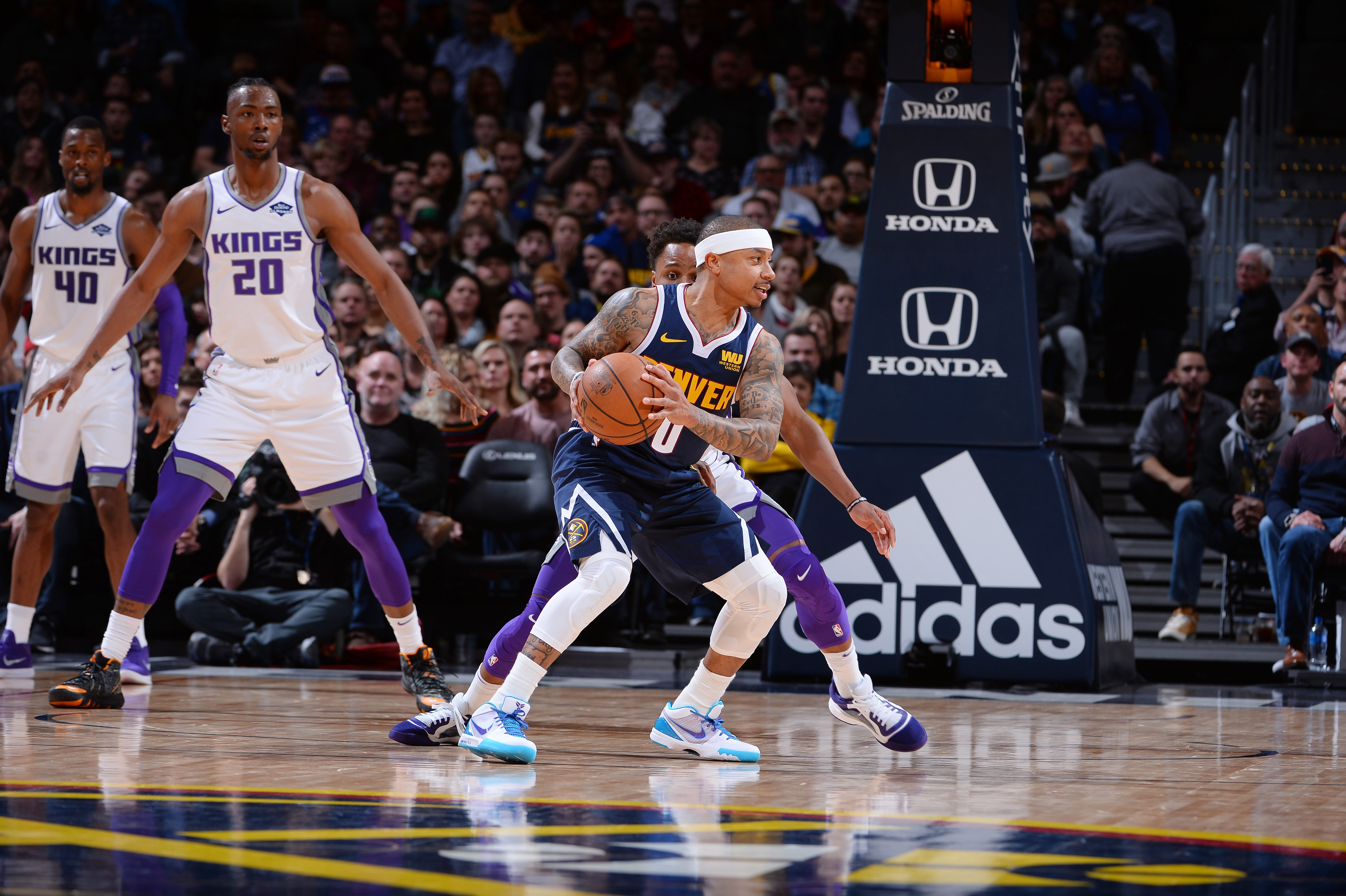 Isaiah Thomas #0 of the Denver Nuggets handles the ball against the Sacramento Kings on February 13, 2019 at the Pepsi Center in Denver
