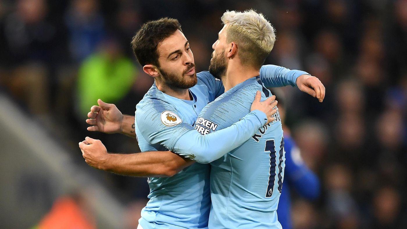 Bernardo Silva of Manchester City celebrates after scoring his team's first goal with Sergio Aguero of Manchester City