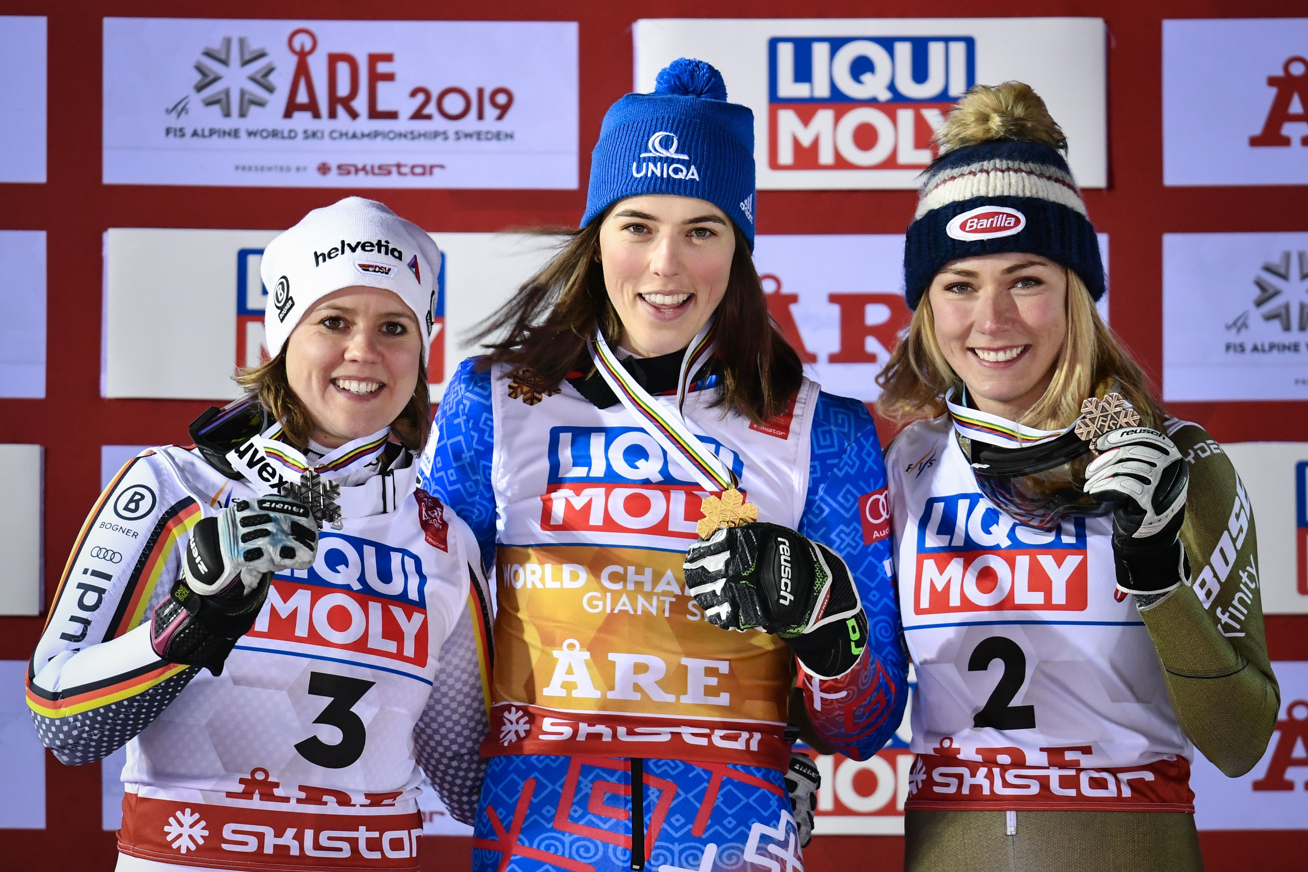 Second placed Germany's Viktoria Rebensburg, first placed Slovakia's Petra Vlhova and third placed US' Mikaela Shiffrin celebrate on the podium after the Women's Giant slalom event at the 2019 FIS Alpine Ski World Championships at the National Arena in Ar