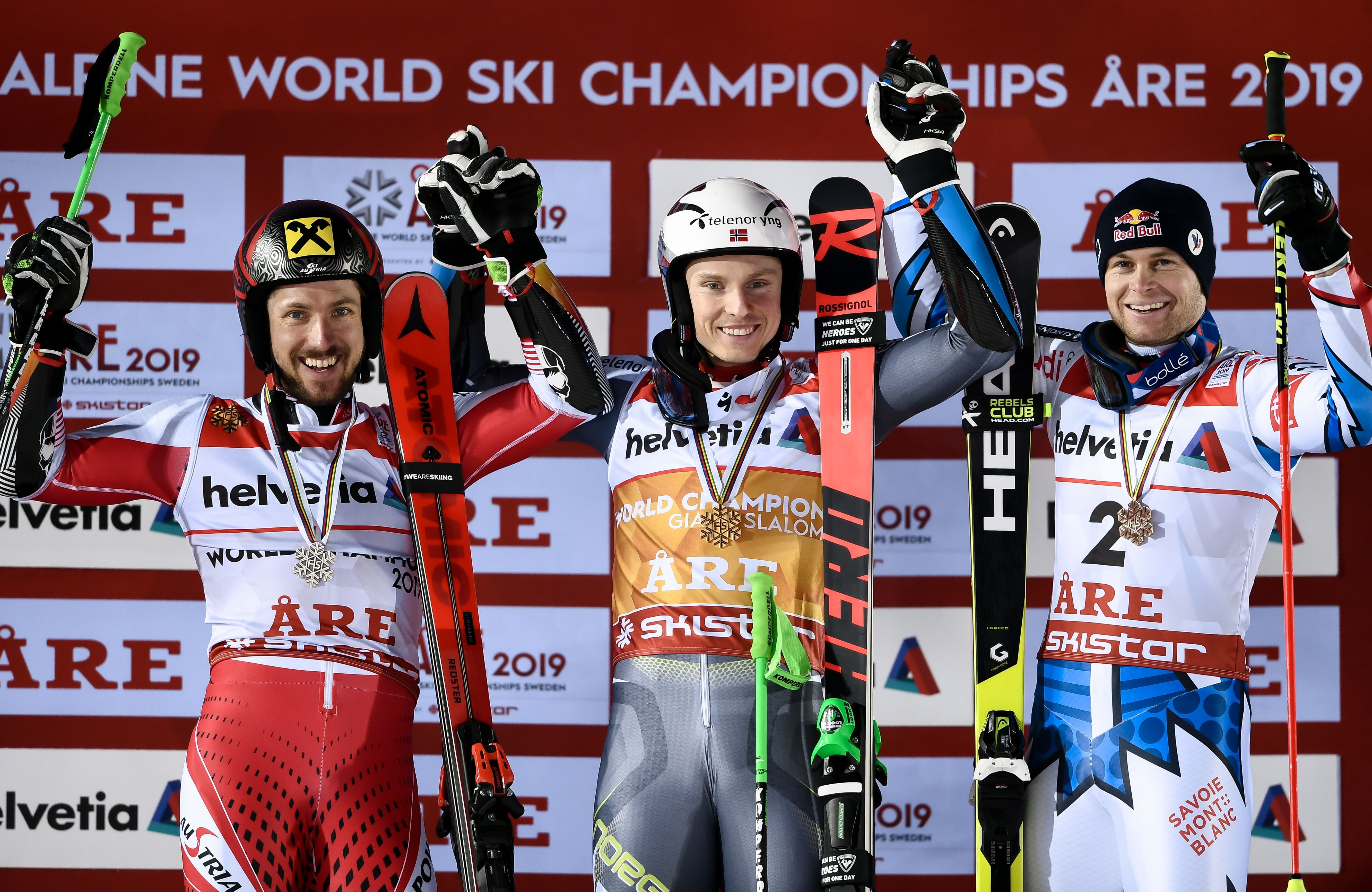 Second placed Austria's Marcel Hirscher, winner Norway's Henrik Kristoffersen, and third placed France's Alexis Pinturault celebrate after the second run of the men's Giant slalom event at the 2019 FIS Alpine Ski World Championships at the National Arena