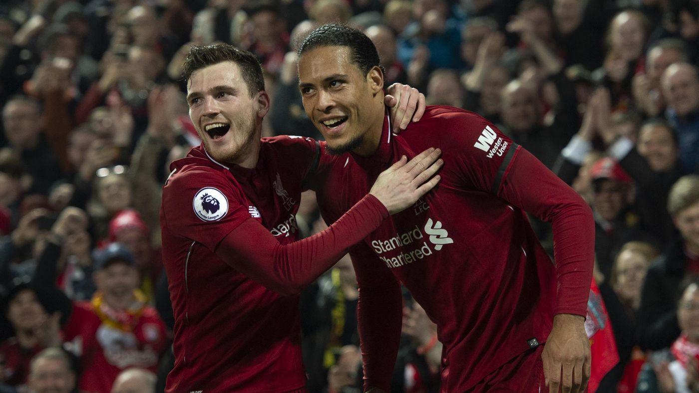 Virgil van Dijk of Liverpool celebrates with team-mate Andrew Robertson