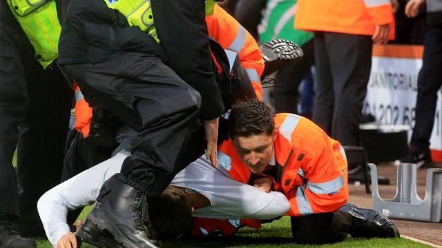 Arrests made after pitch invasions at Bournemouth and Swansea