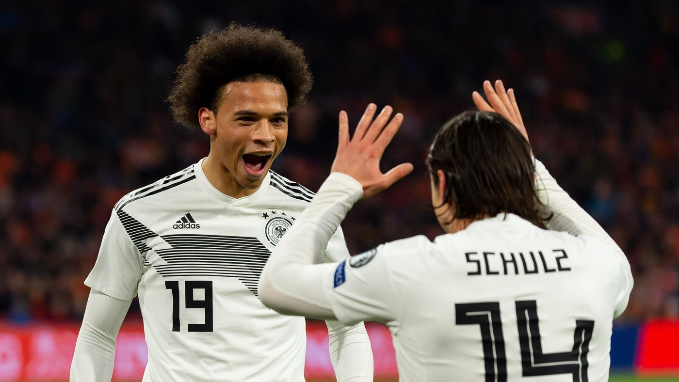 Leroy Sane of Germany celebrates after scoring his team's first goal with team mates during the 2020 UEFA European Championships group C qualifying match between Netherlands and Germany at Johan Cruijff ArenA on March 24, 2019 in Amsterdam, Netherlands.