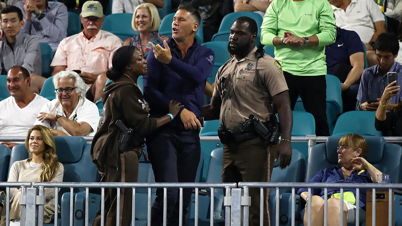 A fan was escorted away after verbals with Kyrgios