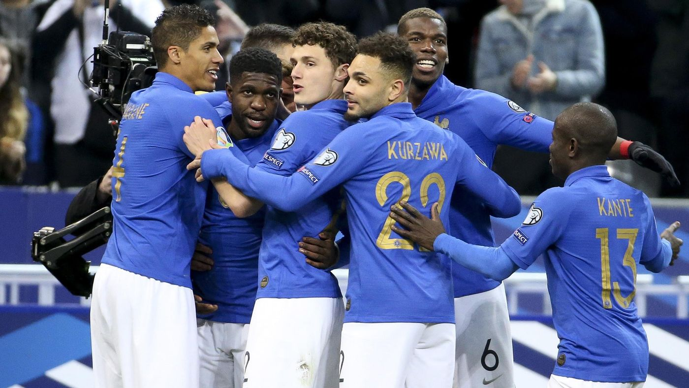 Samuel Umtiti of France celebrates his goal with Raphael Varane, Benjamin Pavard, Layvin Kurzawa, Paul Pogba and teammates during the 2020 UEFA European Championships group H qualifying match between France and Iceland.