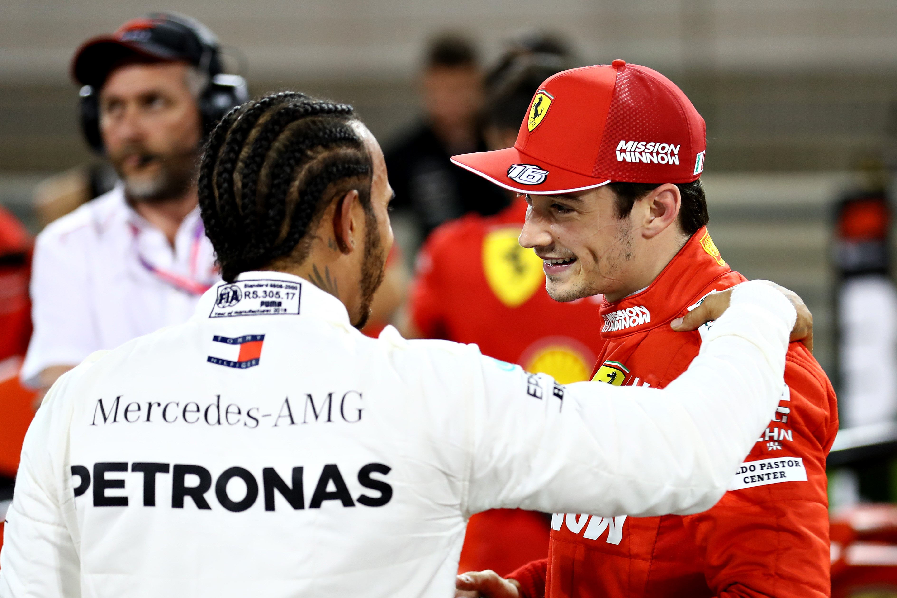Pole position qualifier Charles Leclerc of Monaco and Ferrari is congratulated by third placed qualifier Lewis Hamilton of Great Britain and Mercedes GP in parc ferme during qualifying for the F1 Grand Prix of Bahrain at Bahrain International Circuit on M