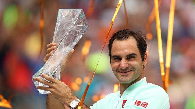 Federer downs injured Isner for 101st career title
