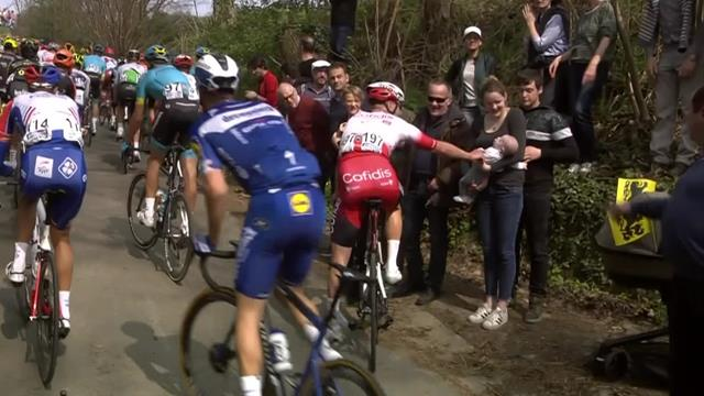 Waeytens greets baby during the race after log-jam