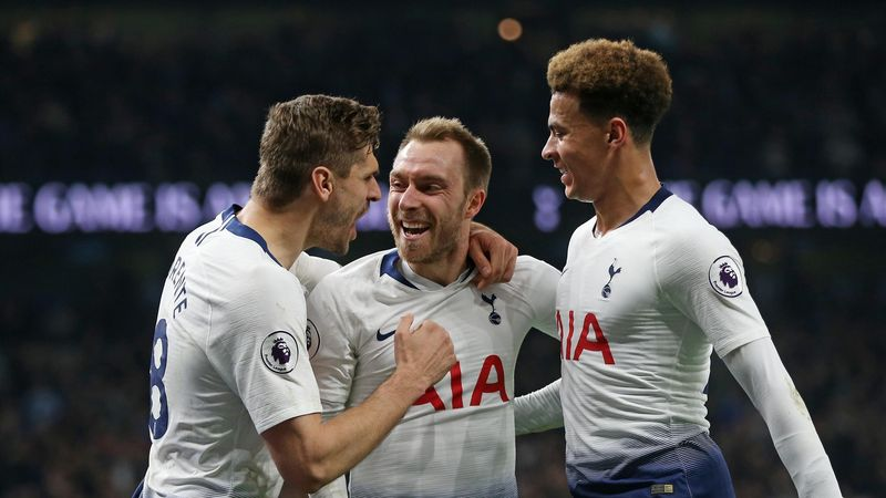 Tottenham Hotspur's Christian Eriksen celebrates scoring his side's first goal with Dele Alli and Fernando Llorente during the Premier League match between Tottenham Hotspur and Brighton & Hove Albion at Tottenham Hotspur Stadium on April 23, 2019 in Lond