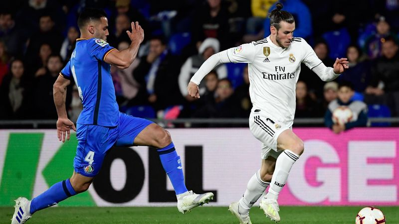 Getafe's Spanish defender Bruno Gonzalez (L) vies with Real Madrid's Welsh forward Gareth Bale during the Spanish league football match between Getafe CF and Real Madrid CF at the Col. Alfonso Perez stadium in Getafe on April 25