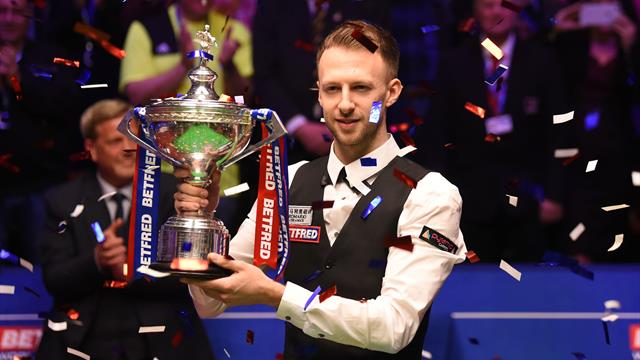 Trump wins first world title with stunning victory over Higgins